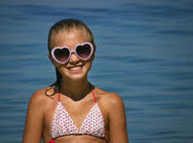 Girl with pink sunglasses at the beach Royalty Free Stock Photography