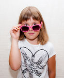 Girl with pink sunglasses. Teen girl poses with pink sunglasses Stock Photography