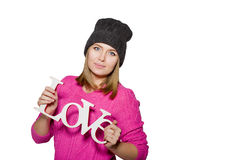 Girl in pink sweater and hat Stock Image
