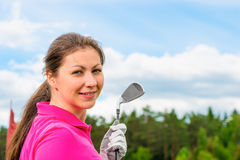 Girl in   pink T-shirt with a golf club. Girl in a bright pink T-shirt with a golf club Royalty Free Stock Image