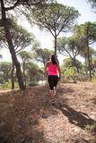 Girl in pink tank top sprinting up hill Royalty Free Stock Images