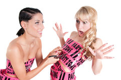 Girl in pink tape dress cuting with scissors Stock Images