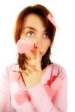 Girl with Pink Top and Valentines. A pretty young girl with a puzzled and bewildered look and wearing a pink top, has a number of pink valentine hearts stuck to Royalty Free Stock Photo