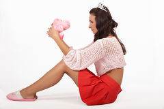 Girl and pink toy Royalty Free Stock Images