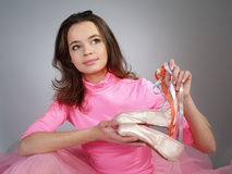 girl  in a pink tutu shows footwear pointes Royalty Free Stock Image