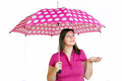 Girl with pink umbrella Stock Photos