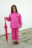 Girl with pink umbrella Stock Image