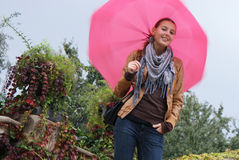 Girl with a pink umbrella Stock Photos