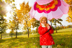 Girl with pink umbrella under the pouring rain Stock Images