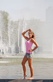 Girl in a pink vest Stock Images