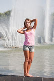 Girl in a pink vest and shorts Royalty Free Stock Photos