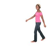 Girl in pink walking across a white background Stock Photo