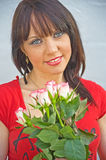 Girl with pink and white roses. An image of an attractive smiling girl holding a bunch of pink and white roses Stock Photography