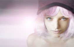 Girl with pink wig. Beautiful girl portrait posing with a pink wig on an abstract background Royalty Free Stock Photos