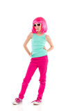 Girl in pink wig posing with hands on hip. Pink haired girl in sunglasses posing with hands on hips. Full length studio shot isolated on white Stock Photos