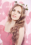 Girl in pink wreath, tinted. Beautiful long-haired woman in pink wreath, tinted Royalty Free Stock Images