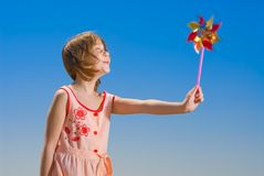 Girl with pinwheel Royalty Free Stock Photos