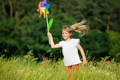 Girl with pinwheel Stock Photos