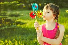Girl with pinwheel Royalty Free Stock Photo