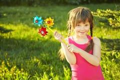Girl with pinwheel Stock Image