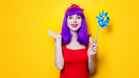 Girl with pinwheel toy Stock Images