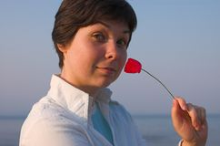 Girl with a pipe near her nose. At the sea Stock Image