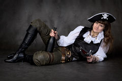 Girl - pirate with pistol and bottle Stock Photography
