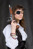 Girl - pirate with pistol in hand and eye patch. On face Royalty Free Stock Image