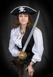 The girl - pirate with a sabre in hands. On a black background Royalty Free Stock Photography