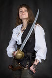 The girl - pirate with a sabre in hands Royalty Free Stock Photos