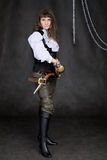 The girl - pirate with a sabre in hands Royalty Free Stock Images