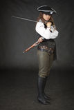 Girl - pirate with sabre and pistol on a black Stock Photography