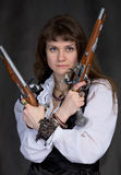Girl - pirate with two ancient pistols in hands Royalty Free Stock Photo