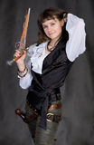 Girl - pirate with two pistols. On black background Stock Image