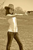 Girl and pistol Stock Photography