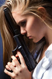Girl with pistol. The young beautiful blonde girl with by big pistol Stock Image