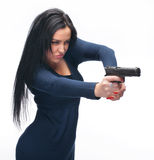 Girl with a pistol. Young girl with a pistol on white background stock photography