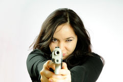 The girl with a pistol. The beautiful girl with a pistol aims Royalty Free Stock Images