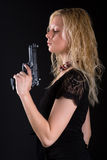 Girl with pistol. Beautiful girl with the big black pistol stock photo