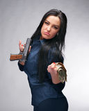 Girl with pistol and money Royalty Free Stock Images