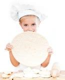 Girl with pizza dough Royalty Free Stock Photos