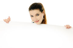 Girl with placard. Cheerful girl with empty placard Royalty Free Stock Photography