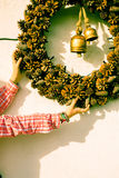 Girl placing Christmas ornaments Royalty Free Stock Image