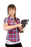 Girl in plaid shirt with charges movie camera Stock Photos
