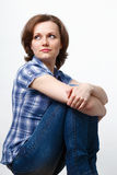 Girl in a plaid shirt and jeans Royalty Free Stock Photo