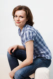Girl in a plaid shirt and jeans Royalty Free Stock Photos