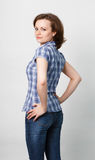 Girl in a plaid shirt and jeans Stock Images