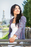 Girl in plaid shirt looking over her shoulder toward the sky Royalty Free Stock Images