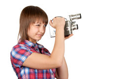 Girl in plaid shirt with movie camera Royalty Free Stock Photo