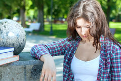 Girl in plaid shirt is sad Stock Photo